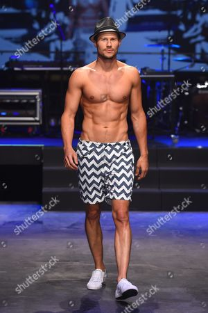 Male Australian Model Jason Dundas Walks the Runway Wearing a Creation by the Rocks Push During the David Jones Spring Summer 2015 Fashion Launch in Sydney Australia 05 August 2015