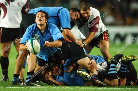 Uruguay's #10 Sebastian Aguirre Gets the Ball Away During the Rugby World Cup 2003 Pool C Match Between Uruguay and Georgia at Sydney's Aussie Stadium Tuesday 28 October 2003 Uruguay Won the Match 24-12