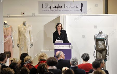 Royal Bride-to-be Kate Middleton's See-through Lace Dress (r) Pictured During an Auction Along Side Princess Diana Dresses (l) in London Britain 17 March 2011 the See-through Knitted Lace Dress Designed by British Designer Charlotte Todd and Worn by Britain's Prince William's Bride to Be Kate Middleton at the St Andrew's Annual Charity Fashion Show in 2002 is Scheduled to Be Sold As Part of Kerry Taylor Auctions' Passion For Fashion and Fine Textiles Sale the Dress Which is Expected to Fetch Between 9 000 and 11 000 Euros is Supposedly to Have Been a Factor in Middleton's Meeting with Prince William the Auction Also Includes Two Dresses Worn by Princess Diana and a Number of Items Once Owned by King Edward Viii's Mistress Wallis Simpson United Kingdom London