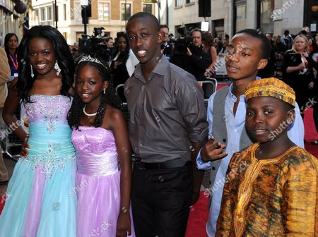 Cast Members (l-r) Sherrie Silver Sanyu Joanita Kintu Roger Nsengiyumva Yves Dusenge and Eriya Ndayambaje Arrive at the Uk Family Gala Premiere of 'Africa United' at the Odeon Leicester Square in London Britian 17 October 2010 the Movie by British Director Debs Gardner-paterson Tells the Story of Two Young Rwandan Boys Fabrice who Comes From a Privileged Background and Dudu who is From an Impoverished Neighborhood They Both Set out on a Long Journey Together to Make It to South Africa in Time For the Soccer World Cup United Kingdom London
