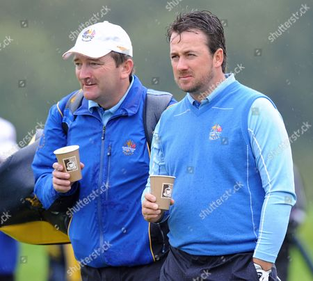 European Ryder Cup Player Graham Mcdowell (r) Enjoys a Cup of Coffee During the Second Days Official Practise with His Caddie on a Rain Soaked Celtic Manor Golf Course Newport Wales 29 September 2010 the Ryder Cup Starts on Friday 01 October 2010 and Finishes on Sunday 03 October 2010 United Kingdom Newport