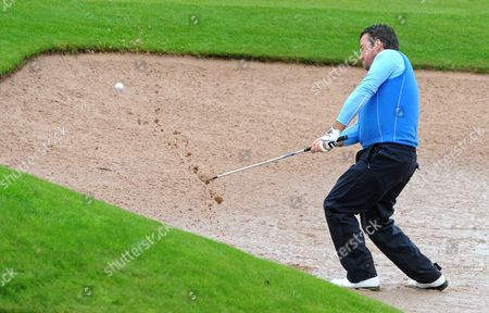European Ryder Cup Graham Mcdowell Plays out of a Rain Soaked Bunker at Celtic Manor Golf Course Newport Wales 29 September 2010 the Ryder Cup Starts on Friday 01 October 2010 and Finishes on Sunday 03 October 2010 United Kingdom Newport
