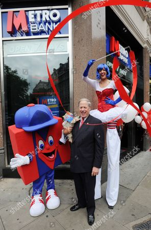 Us Billionaire and Co-founder of Metro Bank Vernon Hill Poses For Pictures Outside a Metro Bank Branch in Holborn London Britain on 29 July 2010 Metro Bank Has Officially Become Britain's First New High Street Lender in More Than 100 Years when It Opens Its First Branch in Central London Today Metro Bank Has Promised to Revolutionise the British Banking Experience Through Offering Retail Opening Hours Unparalleled Service and a Simple Range of Products and Will Allow Dogs and Provide Them with a Bowl of Water and a Bone United Kingdom London