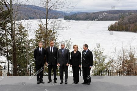 Norwegian Minister of Foreign Affairs Jonas Gahr St°re (l) Russian Minister of Foreign Affairs Sergey Viktorovich Lavrov (2-l) Canadian Foreign Affairs Minister Lawrence Cannon (c) Us Secretary of State Hillary Clinton (2-r) and Danish Minister of Justice Lars Barfoed (r) Pose For a Family Photo in Front of Lake Meech at the Arctic Ocean Foreign Ministers Meeting at Wilson House in Chelsea Quebec Canada 29 March 2010 the Dignitaries Are Meeting to Consult on Critical Political Issues Stability in Afghanistan and Pakistan Arms Control Disarmament and Other Security Vulnerabilities Canada Chelsea