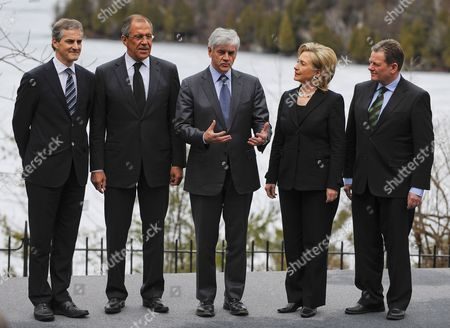 Canadian Foreign Affairs Minister Lawrence Cannon (c) Gestures As He Poses with Norway's Minister of Foreign Affairs Jonas Gahr Store (l) Russian Minister of Foreign Affairs Sergey Viktorovich Lavrov (2-l) U S Secretary of State Hillary Rodham Clinton (2-r) and Denmark's Minister of Justice Lars Barfoed (r) For a Group Photo During the Arctic Ocean Foreign Ministers' Meeting at Wilson House in Chelsea Quebec Canada 29 March 2010 Frozen Lake Meech is in the Background Canada Chelsea
