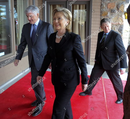 U S Secretary of State Hillary Rodham Clinton (c) Walks with Canadian Foreign Affairs Minister Lawrence Cannon (l) and Denmark's Minister of Justice Lars Barfoed (r) As They Return to Work After a Photo Session During the Arctic Ocean Foreign Ministers' Meeting at Wilson House in Chelsea Quebec Canada 29 March 2010 Canada Chelsea