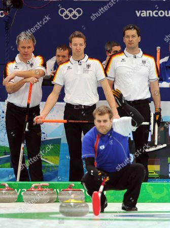Stock Photo of Germany's Andras Kempf (top L) Daniel Herberg (top C) and Andy Kapp (top R) Watch France's Tony Angiboust (bottom) During Action of Their Round Robin Match in the Men's Curling Competition at the Vancouver 2010 Olympic Games Vancouver Canada 20 February 2010 Germany Won 9-4 Epa/dan Levine Canada Vancouver