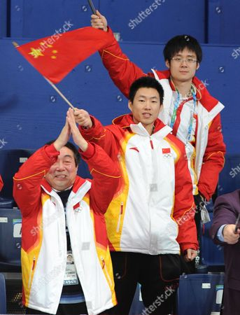 Chinese Men's Curlers Xiaoing Xu (r) and Rui Lui (c) and Chinese Sport Delegation General Secretary (zhou Ying Gang (l) Celebrates Thechinese Women's Team's 12-6 Victory Over Switzerland in Their Bronze Medal Match in the Women's Curling Competition at the Vancouver 2010 Olympic Games Vancouver Canada 26 February 2010 Canada Vancouver