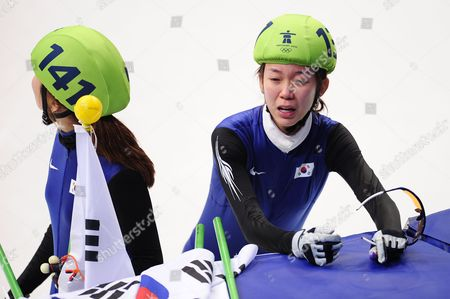 The Dejected Korean Team of (l-r) Seung-hi Park and Ha-ri Cho Cry After They Realise That They Have Been Disqualified During the Vancouver 2010 Olympic Games Ladies' Short Track Speed Skating 3000m Relay Competition at Pacific Coliseum in Vancouver British Columbia Canada 24 February 2010 Canada Vancouver
