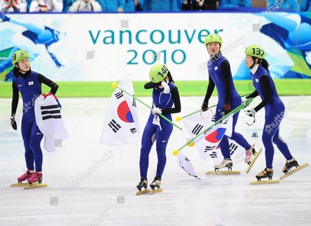 The Dejected Korean of (l-r) Min-jung Kim Eun-byul Lee Seung-hi Park and Ha-ri Cho Realise That They Have Been Disqualified During the Vancouver 2010 Olympic Games Ladies' Short Track Speed Skating 3000m Relay Competition at Pacific Coliseum in Vancouver British Columbia Canada 24 February 2010 Canada Vancouver