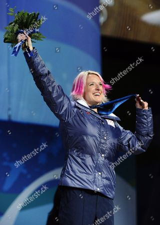 United States Women's Moguls Bronze Medal Winner Shannon Bahrke Holds Up Her Medal While Standing on the Podium During the Medaling Ceremony at Bc Place at the Vancouver 2010 Olympic Games in Vancouver Canada 14 February 2010 Canada Vancouver