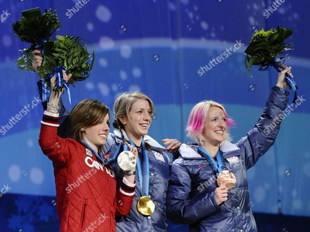 Women's Moguls Gold Medal Winner Hannah Kearney From the United States (c) Bronze Medal Winner Shannon Bahrke From the United States (r) and Silver Medalist Jennifer Heil (l) From Canada on the Podium During the Medaling Ceremony at Bc Place at the Vancouver 2010 Olympic Games in Vancouver Canada 14 February 2010 Canada Vancouver
