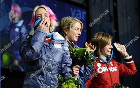 Women's Moguls Gold Medal Winner Hannah Kearney From the United States (c) Bronze Medal Winner Shannon Bahrke From the United States (l) and Silver Medalist Jennifer Hel (r) From Canada on the Podium During the Medal Ceremony at Bc Place at the Vancouver 2010 Olympic Games in Vancouver Canada 14 February 2010 Canada Vancouver