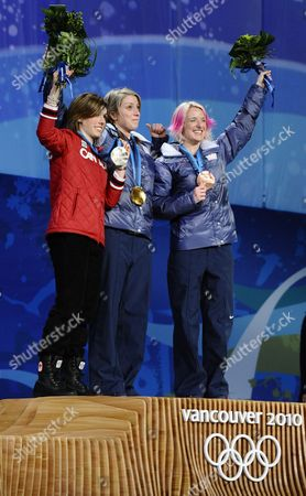Stock Photo of Women's Moguls Gold Medal Winner Hannah Kearney From the United States (c) Bronze Medal Winner Shannon Bahrke From the United States (r) and Silver Medalist Jennifer Hel (l) From Canada on the Podium During the Medal Ceremony at Bc Place at the Vancouver 2010 Olympic Games in Vancouver Canada 14 February 2010 Canada Vancouver