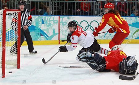 Switzerland's Stefanie Marty (l) Scores a Goal Against China's Goalkeeper Jia Dandan (bottom) As China's Sun Rui (r) Looks on During Their Classification Match of Women's Ice Hockey Tournament at the Vancouver 2010 Olympic Games Vancouver Canada Friday 20 February 2010 Canada Vancouver