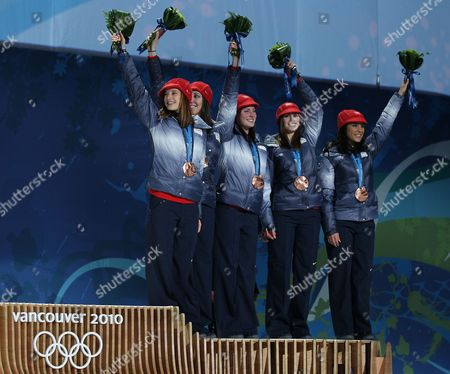 Third Placed Allison Baver Alyson Dudek Lana Gehring and Katherine Reutter of Usa Wave on the Podium During the Medal Ceremony of Ladies Short Track 3000m Relay at the Bc Center For the Vancouver 2010 Olympic Games Vancouver Canada 25 February 2010 Canada Vancouver