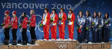 Second Placed Tania Vicent Marianne St-gelais Kalyna Roberge and Jessica Gregg of Canada Gold Medalists Linlin Sun Meng Wang Hui Zhang and Yang Zhou of China and Third Placed Allison Baver Kimberly Derrick Alyson Dudek Lana Gehring Katherine Reutter of Usa Wave on the Podium During the Medal Ceremony of Ladies Short Track 3000m Relay at the Bc Center For the Vancouver 2010 Olympic Games Vancouver Canada 25 February 2010 Canada Vancouver