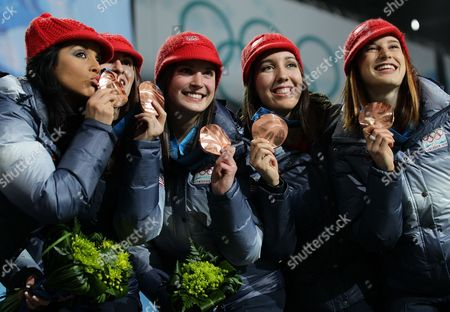 Third Placed Katherine Reutter Lana Gehring Alyson Dudek Kimberly Derrick and Allison Baver of Usa Wave on the Podium During the Medal Ceremony of Ladies Short Track 3000m Relay at the Bc Center For the Vancouver 2010 Olympic Games Vancouver Canada 25 February 2010 Canada Vancouver