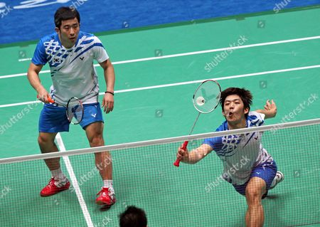 Jaesung Chung (l) and Yongdae Lee of South Korea in Action During Their Submatch Against Cai Yun and Fu Haifeng of China in the Men's Team Final at the 16th Asian Games in Guangzhou Southern China's Guangdong Province 15 November 2010 Chung and Lee Won 19-21 21-16 and 21-18 China Guangzhou
