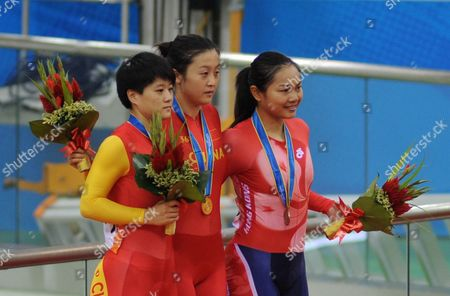 Gold Medalist Guo Shuang of China (c) Silver Medalist Lin Junhong of China (l) and Bronze Medalists Lee Wai Sze of Hong Kong Celebrate on the Podium During the Medal Ceremony in Women's Sprint Final of Cycling Track Event at the Guangzhou 2010 Asian Games at Aoti Aquatics Centre of Guangzhou City Southern China's Guangdong Province 17 November 2010 China Guangzhou