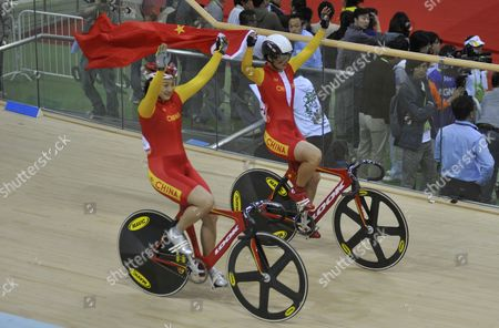 Gold Medalist Guo Shuang of China (l) Silver Medalist Lin Junhong of China Celebrate After the Women's Sprint Final of Cycling Track Event at the Guangzhou 2010 Asian Games at Guangzhou Velodrome of Guangzhou City Southern China's Guangdong Province 17 November 2010 China Guangzhou