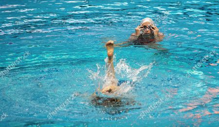Stock Image of England's Synchronized Swimming Team Member Asha Randall (top) During a Training Session For the Commonwealth Games 2010 at the Spm Aquatics Complex in New Delhi India 05 October 2010 India New Delhi