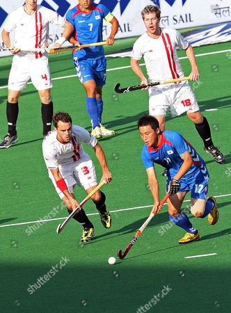 South Korea's Hong Eun-seong (r) Vies with Canada's Philip Wright During Their Group a Match of the Field Hockey Championships in New Delhi India on 07 March 2010 Korea Won 9-2 India New Delhi