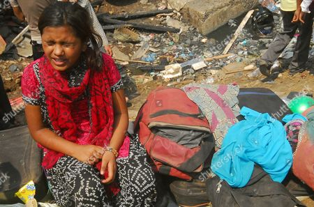 Rubina Ali who Acted As Young Latika in the Oscar-winning Film 'Slumdog Millionaire' with Her Belongings Near the Ruins of the Shanty She Lived in at Garib Nagar Slums Mumbai India 05 March 2011 a Fire Gutted the Slum a Large Shanty Town Which is Home to Thousands of Residents Next to Bandra Station in Mumbai's Suburbs on 04 March 2011 India Mumbai