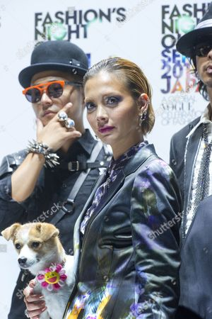 Japanese Celebrities Rapper Musician Verbal (l) Pon-chan (artist Takeshi Murakami's Dog and Event Mascot) and Fashion Model Anna Tsuchiya (c) and Musician Kento Mori (r) Pose During the Vogue Fashion's Night out 2010 in the Ometesando Fashion District of Tokyo Japan 11 September 2010 Vogue Fashion's Night out First Started in 2009 Under the Supervision of the Us Vogue Editor-in-chief Anna Wintour the 2010 Edition of the Fashion Event is Held in 16 Countries Japan Tokyo