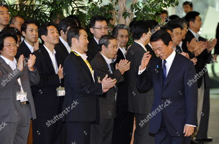 Japan's Outgoing Prime Minister Taro Aso (r) Acknowledges to Staff Members As He Leaves His Official Residence in Tokyo Japan 16 September 2009 His Successor Democratic Party of Japan Leader Yukio Hatoyama is Set to Be Elected As Japan's New Prime Minister Later in the Day and to Launch a New Coalition Government Japan Tokyo