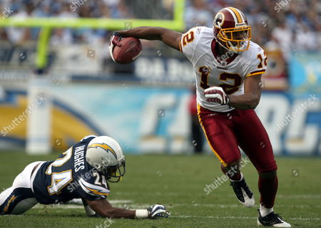 Washington Redskins Wide Receiver Malcolm Kelly Eludes the San Diego Chargers Cornerback Dante Hughes For an Eight-yard Gain to the Four-yard-line in the Second Quarter in an Nfl Football Game at Qualcomm Stadium in San Diego California Usa 03 January 2010 United States San Diego