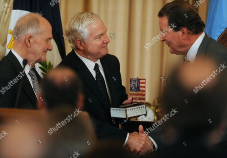Us Secretary of Defense Robert Gates (c) Shakes Hands with John Adams Jr (r) Chairman of the Board of the George C Marshall Foundation While Receiving the George C Marshall Foundation Award As Retired Lieutenant General Brent Scowcroft (l) of the United States Air Force Looks on in Washington Dc Usa 16 October 2009 Marshall was an American Military Leader Chief of Staff of the Army Secretary of State and the Third Secretary of Defense Marshall is Considered to Be the 'Architect of Victory' in World War Ii and in 1953 He Won the Nobel Peace Prize Secretary of Defense Gates Received the George C Marshall Foundation Award at a Luncheon to Commemorating the 50th Anniversary of George C Marshall's Death and Honoring Marshall's Life and Legacy United States Washington