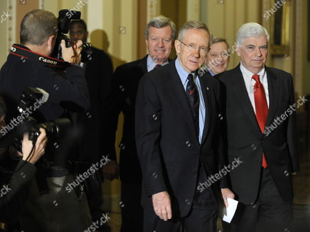 Us Senate Majority Leader Harry Reid (c D-nevada) Leads Fellow Democrats to Speak to the Press After the Senate Passed a Landmark Health Care Bill Which Will Provide Near Universal Care in the United States For the First Time in History on Capitol Hill in Washington D C Usa 24 December 2009 Following Reid Are (l-r) Sen Max Baucus (d-montana) Sen Dick Durbin (d-illinois) and Sen Christopher Dodd (d-connecticut) the Legislation Which Passed 60-39 Must Still Be Reconciled with a House Version But Could Add Health Insurance to 30 Million More Americans United States Washington