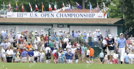 Rory Mcilroy of Northern Ireland (r) and His Caddie J P Fitzgerald (l) Walk Up the Fairway on the First Hole During the Final Round at the 2011 U S Open Championship at Congressional Country Club in Bethesda Maryland Usa on 19 June 2011 Rory Mcilroy of Northern Ireland Started the Final Round with an 8-stroke Lead Over the Rest of the Field United States Bethesda