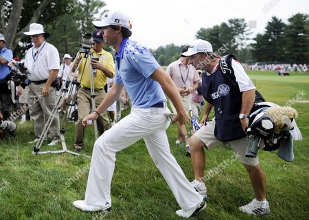 Rory Mcilroy of Northern Ireland (l) Walks Up From the Green on the Third Hole Followed by His Caddie J P Fitzgerald (r) During the Final Round at the 2011 U S Open Championship at Congressional Country Club in Bethesda Maryland Usa on 19 June 2011 Rory Mcilroy of Northern Ireland Started the Final Round with an 8-stroke Lead Over the Rest of the Field United States Bethesda