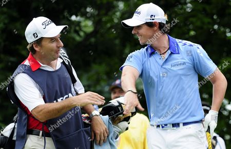 Rory Mcilroy of Northern Ireland (r) Celebrates with His Caddie J P Fitzgerald (l) After His Tee Shot on the Tenth Hole During the Final Round at the 2011 U S Open Championship at Congressional Country Club in Bethesda Maryland Usa on 19 June 2011 Rory Mcilroy of Northern Ireland Started the Final Round with an 8-stroke Lead Over the Rest of the Field United States Bethesda
