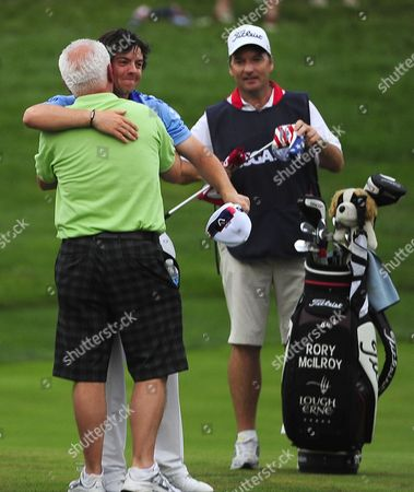 Rory Mcilroy of Northern Ireland (c) Hugs His Father Gerry (l) As His Caddie J P Fitzgerald (r) Watches After He Made His Final Putt to Win the 2011 U S Open Championship at Congressional Country Club in Bethesda Maryland Usa on 19 June 2011 Mcilroy Finished at 16 Under Par 8 Strokes Ahead of Jason Day of Australia United States Bethesda
