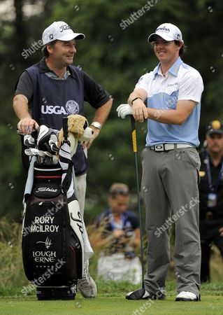 Rory Mcilroy of Northern Ireland (r) Talks with His Caddie J P Fitzgerald (l) on the Sixteenth Hole During the Third Round at the 2011 U S Open Championship at Congressional Country Club in Bethesda Maryland Usa on 18 June 2011 the 2011 U S Open Championship Will Be Played Over Four Days Between 16 and 19 June 2011 United States Bethesda