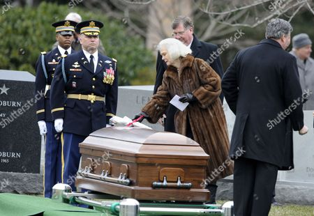Stock Photo of Patricia Haig Widow of Former Secretary of State and Retired Army General Alexander Haig Places Flowers on Her Husbands Casket During His Full Honors Funeral at Arlington National Cemetery in Arlington Virginia Usa 02 March 2010 Haig was a United States Army General who Served As the United States Secretary of State Under President Ronald Reagan and White House Chief of Staff Under Presidents Richard Nixon and Gerald Ford He Also Served As Vice Chief of Staff of the Army the Second-highest Ranking Officer in the Army and As Supreme Allied Commander Europe Commanding All U S and Nato Forces in Europe United States Arlington