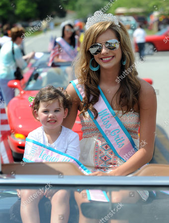 Teeny Miss Grits Ava Dean 2 (l) and Miss Grits Lindsay Dobbs 16 Participate in the Parade During the 14th Annual National Grits Festival in Warwick Georgia Usa 09 April 2011 Grits a Food Made From Coarsely Ground Corn is of Native American Origin and Common in the Southern United States United States Warwick
