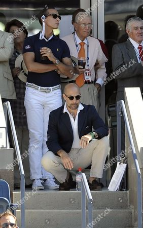 Us Actor Stanley Tucci (c) Watches As Roger Federer of Switzerland Plays Novak Djokovic of Serbia (neither Pictured) During Their Semifinal Round Match at the 2010 Us Open Tennis Championship at the Usta National Tennis Center in Flushing Meadows New York Usa 11 September 2010 the Us Open Championship Runs Through 12 September when the Men's Final is Scheduled to Be Played United States Flushing Meadows