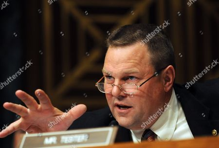 Us Senator Jon Tester D-mon Asks Lloyd C Blankfein Chairman and Chief Executive Officer the Goldman Sachs Group Questions During a Hearing of the Us Senate Permanent Subcommittee on Investigations During a Hearing on 'Wall Street and the Financial Crisis: the Role of Investment Banks ' on Capitol Hill in Washington Usa 27 April 2010 the Hearing Focuses on the Role of Investment Banks in the Securitization of Residential Mortgage Related Products United States Washington