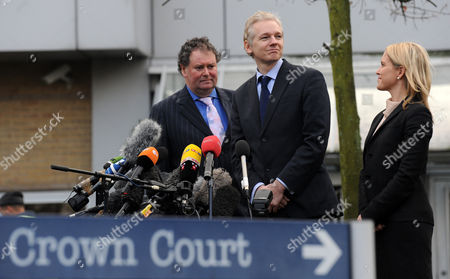 Wikileaks Founder Julian Assange Delivers a Statement to the Press Outside Belmarsh Magistrates Court in Southeast London 11 January 2011 Assange Appeared in Court For a Hearing Linked to Sweden's Request For His Extradition on Sexual Offence Allegations on Left is Lawyer Mark Stevens and on Right a Member of the Legal Team United Kingdom London