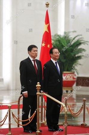 Stock Photo of Chinese Premier Wen Jiabao and Mongolian Prime Minister Sukhbaataryn Batbold Listen to Their Country's National Anthem During a Welcome Ceremony Inside the Great Hall of the People in Beijing China 16 June 2011 Batbold is in China on a 3-day Official Visit China Beijing