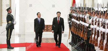 Stock Picture of Chinese Premier Wen Jiabao (center L) and Mongolian Prime Minister Sukhbaataryn Batbold (center R) Inspect a Guard of Honor During a Welcome Ceremony Inside the Great Hall of the People in Beijing China 16 June 2011 Batbold is in China on a 3-day Official Visit China Beijing