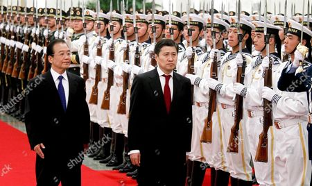 Stock Image of Chinese Premier Wen Jiabao (center L) and Mongolian Prime Minister Sukhbaataryn Batbold (center R) Inspect a Guard of Honor During a Welcome Ceremony Inside the Great Hall of the People in Beijing China 16 June 2011 Batbold is in China on a 3-day Official Visit China Beijing