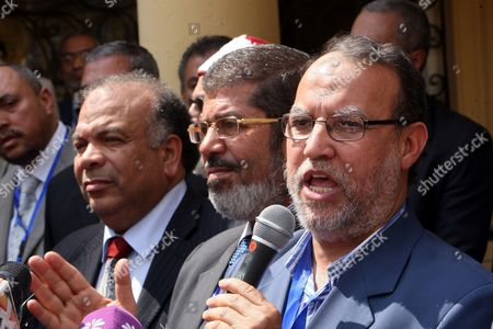 Officials of the Newly Formed Freedom and Justice Party Vice President Essam El-arian (r) President Mohammed Morsi (c) and Secretary General Saad Al-katatni (l) During a Press Conference After the Muslim Brotherhood Shura Council Meeting in Cairo Egypt 30 April 2011 the Muslim Brotherhood Announced on 30 April That the New Freedom and Justice Party Will Be Representing the Muslim Brotherhood Contesting Up to 50 Per Cent of the Parliament Seats in the Upcoming Elections Scheduled For September the Group Approved a Programme For Their Freedom and Justice Party Which They Decided to Form Following the January 25 Uprising That Forced Former President Hosni Mubarak and His Government out of Power Egypt Cairo