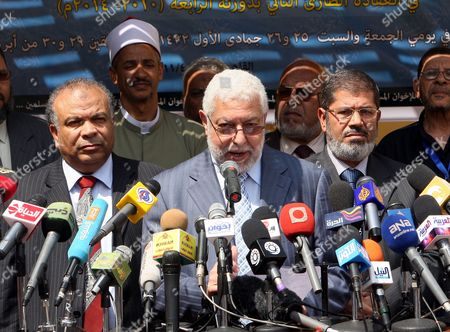 Egyptian Secretary General of Muslim Brotherhood Mahmoud Hussein (c) Leaders of the Newly Formed Freedom and Justice Party President Mohammed Morsi (r) and Secretary General Saad Al-katatni (l) Address a Press Conference After the Muslim Brotherhood Shura Council Meeting in Cairo Egypt 30 April 2011 the Muslim Brotherhood Announced on 30 April That the New Freedom and Justice Party Will Be Representing the Muslim Brotherhood Contesting Up to 50 Per Cent of the Parliament Seats in the Upcoming Elections Scheduled For September the Group Approved a Programme For Their Freedom and Justice Party Which They Decided to Form Following the January 25 Uprising That Forced Former President Hosni Mubarak and His Government out of Power Egypt Cairo