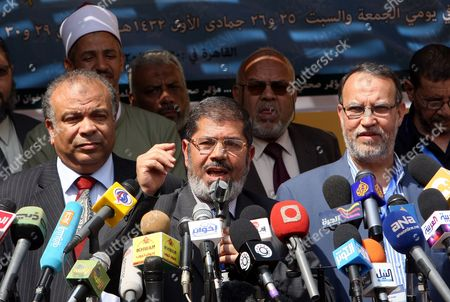 Leaders of the Newly Formed Freedom and Justice Party President Mohammed Morsi (c) Vice President Essam El-arian (r) and Secretary General Saad Al-katatni (l) Address a Press Conference After the Muslim Brotherhood Shura Council Meeting in Cairo Egypt 30 April 2011 the Muslim Brotherhood Announced on 30 April That the New Freedom and Justice Party Will Be Representing the Muslim Brotherhood Contesting Up to 50 Per Cent of the Parliament Seats in the Upcoming Elections Scheduled For September the Group Approved a Programme For Their Freedom and Justice Party Which They Decided to Form Following the January 25 Uprising That Forced Former President Hosni Mubarak and His Government out of Power Egypt Cairo