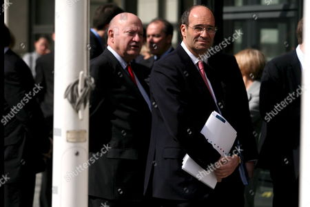 French Budget Minister Eric Woerth (r) and Andre Santini (l) Mayor of Issy-les-moulineaux Wait to Welcome French President Nicolas Sarkozy (not Pictured) at the Finance Ministry of Bercy to Officialy Announce the New Budget and Public Financial Plan in Paris France 04 April 2008